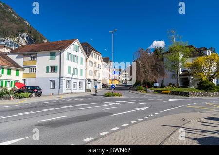 View of buildings and an intersection in the center of Gersau, a village in the canton of Schwyz, Switzerland. - Stock Image