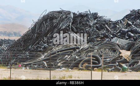 Recycling discarded plastic products, irrigation, drain pipe, planting pots, cable, sanitary landfill. - Stock Image