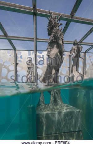 Statues of the Coralarium with coral in Maldives - Stock Image