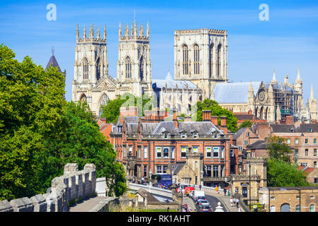 York Minster and a section of the historic city walls along Station road York England Yorkshire England gb uk Europe - Stock Image