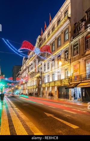 Street adorned with Christmas lights, Baixa district, Lisbon, Portugal - Stock Image