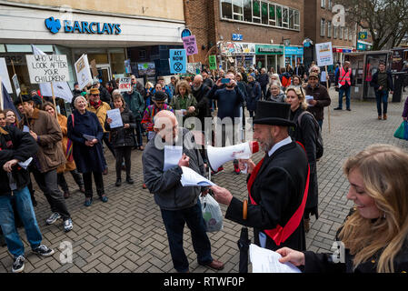 Canterbury, UK. 23rd February 2019. Supporters of the Canterbury Extinction Rebellion Group form up in the City Centre then take part in a symbolic funeral procession representing the death of plants, animals, humans and the planet due to the climate crisis, loss or life. The protest culminated in a swarming action blocking St. Peters Place. Police were present but didn't interfere, there were no arrests. Credit: Stephen Bell/Alamy Live News - Stock Image