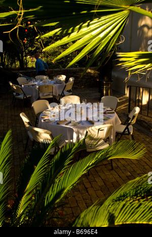 La Villita dining open air restaurant table surrounded green plants historic arts village san Antonio texas tx tourist - Stock Image