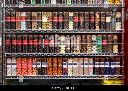 A neat display of jars of Kopper's chocolates and candies at ECONOMY CANDY on Rivington Street on the lower east side of Manhattan, New York City. - Stock Image