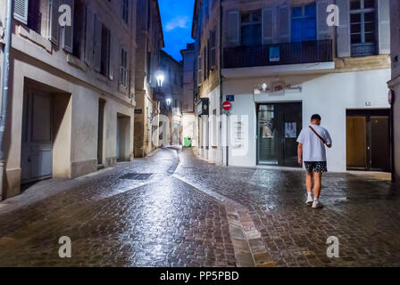 Avignon, FRANCE, Man Walking on Street, at Night Alone, Old City Scenes - Stock Image