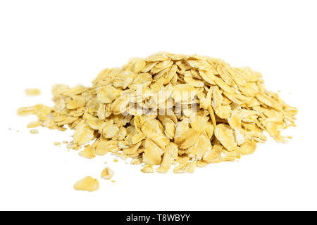 A handful of oat flakes close-up isolated on white - Stock Image