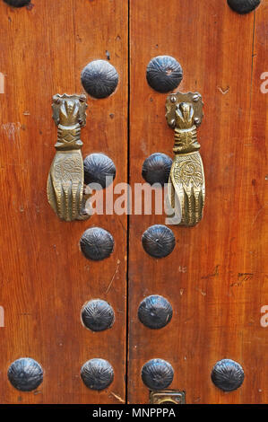 A decorative door and knockers on a house in the Souk of the Moroccian city of Marrakech - Stock Image