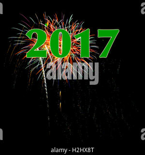 Year 2017 green numbers fireworks black background for New Year's Day or New Year's Eve concept copy space - Stock Image