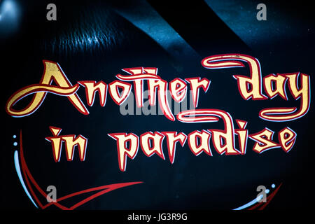 'Another day in paradise' - name of one of the popular songs of the musician Phil Colins on a Harley Davidson - Stock Image