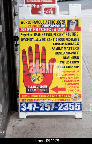 An advertisement for an astrologer & psychic who cures all problems and brings people back from the dead. All this with 100% satisfaction guaranteed. - Stock Image