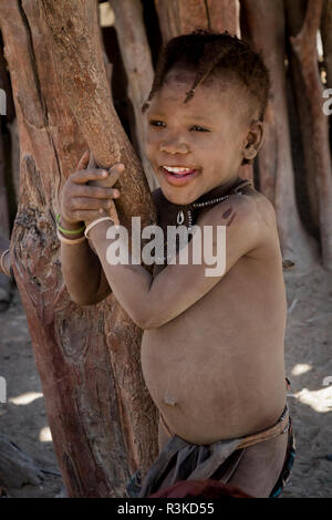 Africa, Namibia, Opuwo. Smiling Himba child. Credit as: Wendy Kaveney / Jaynes Gallery / DanitaDelimont.com - Stock Image