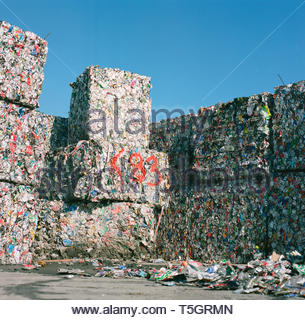 Bales of empty crushed tin cans, await recycling. Swansea, south Wales, UK. - Stock Image