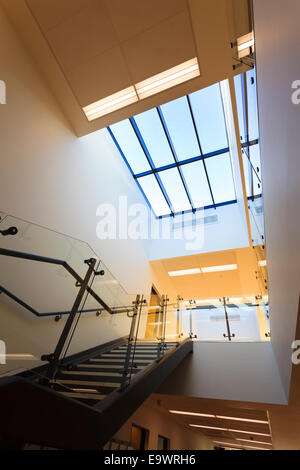 Looking up stairs into atrium of corridor of modern building - Stock Image