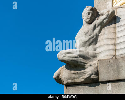 A reclining figure on a memorial in Liverpool to mark the Titanic. - Stock Image