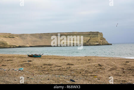 View of a modernist abandoned over the cliff, from the Tombwa beach , Namibe Province, Tombwa, Angola - Stock Image