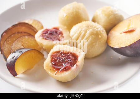 Austrian traditional dumplings filled with plum on white - Stock Image