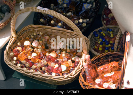 Miniature bottles of Koum Kouat in baskets - Stock Image