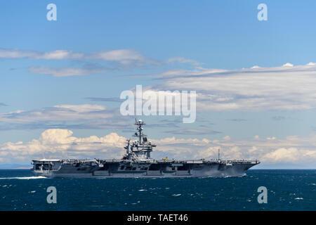 The US nuclear powered aircraft carrier USS John C. Stennis (CVN-74) in the Strait of Juan de Fuca near Port Angeles, Washington State, USA - Stock Image