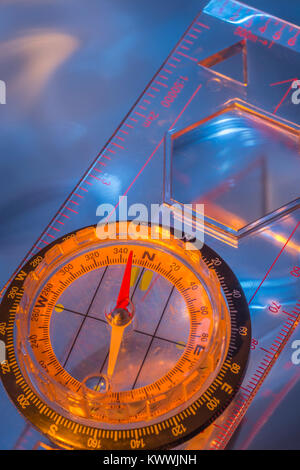 Macro-photo of compass rose face with needle - with copy space. Outward Bound concept. - Stock Image