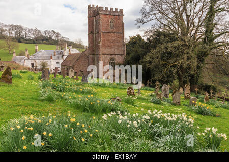 St Pancras church and church yard, West Bagborough, during spring. Manor house in background. - Stock Image