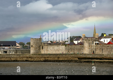 Storm Clouds and Rainbow Over Caernarvon, Gwynedd, North Wales, UK - Stock Image