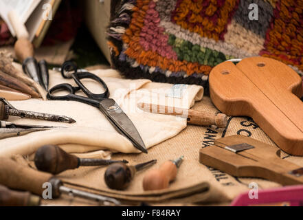 Selection of traditional tools used in the craft of carpet weaving by hand - Stock Image
