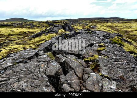 cracked volcanic lava landscape on Iceland - Stock Image