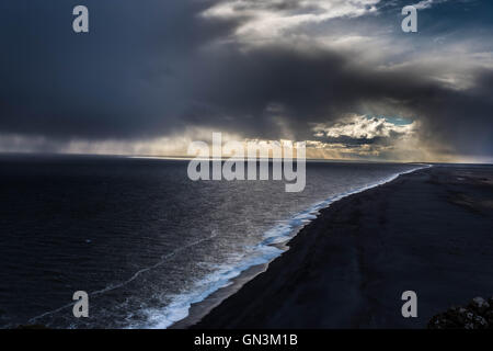 Black Sand Beach Storm, Cliff Side View, Iceland Landscapes - Stock Image
