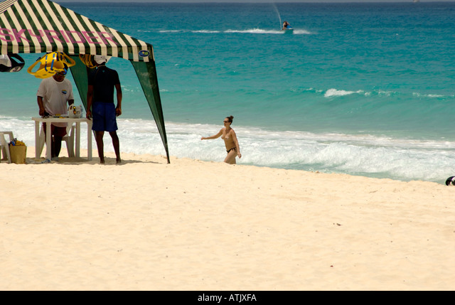 Naked girls on cancun beach Young Topless Girl Walking Out Of The Ocean Jet Ski Rental Tent In Foreground Stock Photo Alamy