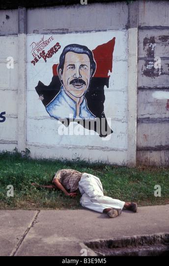 drunken-man-sleeping-in-front-of-a-sandi