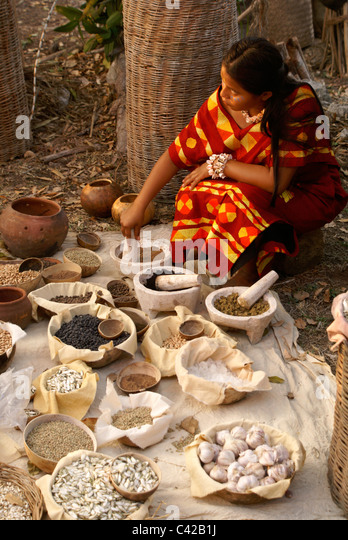woman-grinding-spices-and-herbs-at-a-may