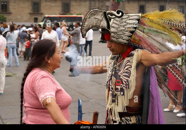 shaman-with-feathered-headdress-performi