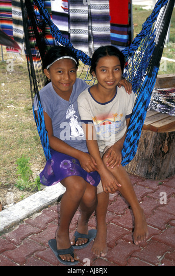 smiling-mayan-girls-sisters-sitting-in-a