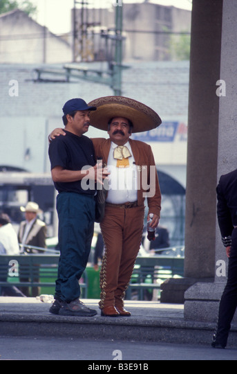 mariachi-player-with-his-arm-around-a-fr
