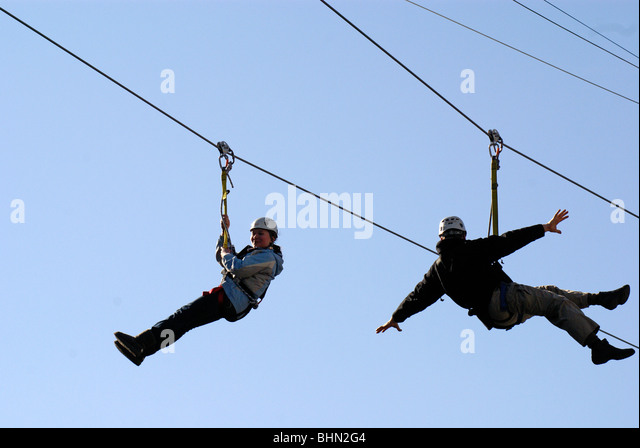 people-ziplining-over-robson-square-duri