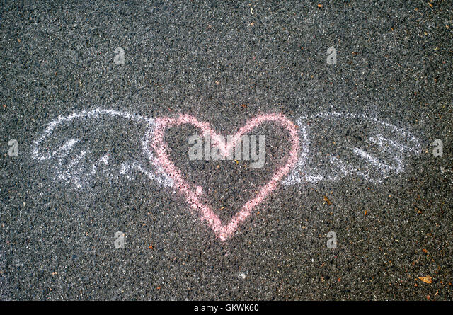 winged-heart-symbol-painted-on-a-concret