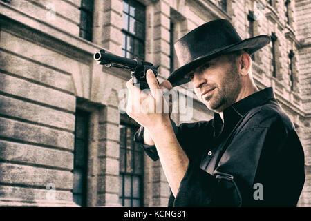 Cowboy mit dem Ziel, ein Gewehr Stockbild