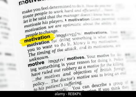 """Englische Wort """"Motivation"""" und seiner Definition im Wörterbuch hervorgehoben. Stockbild"""