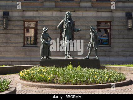 Skulptur Gruppe außerhalb der Nationaltheater in Oslo, Norwegen, den Dramatiker Ludvig Holberg und zwei seiner Zeichen Stockbild