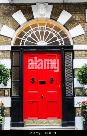 England, London, Westminster, Harley Street, rote Haus Tür Stockbild