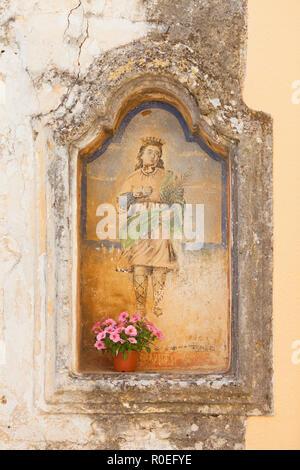 Presicce, Apulien, Italien - einem alten religiösen Malerei in den Straßen von Presicce Stockbild