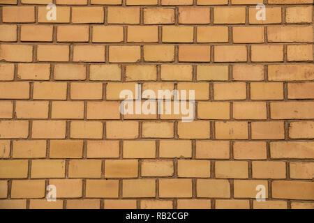 Alte, leere brick House Factory Wand mit gelben Backsteinen Stockbild
