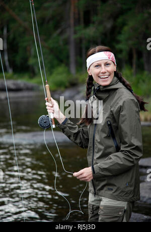 Eine Frau angeln Stockbild