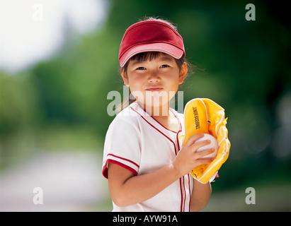 Mädchen in uniform baseball Stockbild