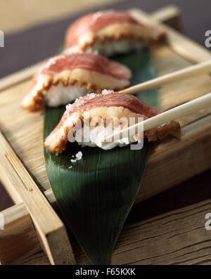 Ente-Sushis mit Apfelsaft Stockbild