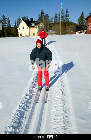Senior Skifahren Stockbild