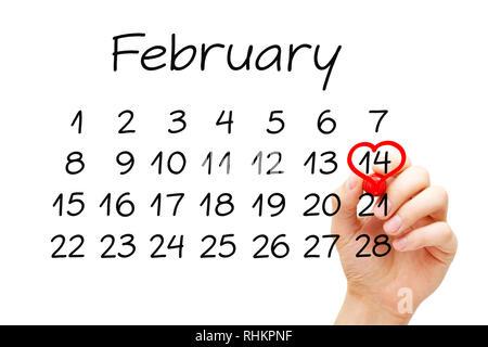 Hand zeichnen ein rotes Herz auf das Datum 14. Februar mit Marker auf transparentem Glas. Valentines Tag Konzept. Stockbild