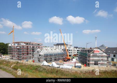 Baukräne, Gerüstbau, Baustelle, raue Gebäude, Wohngebäude, Cloppenburg, Niedersachsen, Deutschland, Europa Stockbild