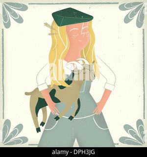 Ein Mädchen mit einer Ziege Stockbild