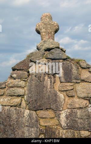 Ein Kreuz aus Stein Stockbild